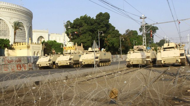 Egyptian Army armoured vehicles sit parked at a checkpoint in Cairo, Egypt, July 08, 2013. UPI/Ahmed Jomaa