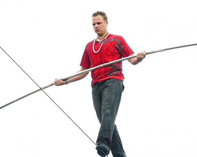 Nik Wallenda walks a high wire that's over 1000 feet long and 200 high above the Allegheny River and Roberto Clemente Bridge without shoes as part of the Three Rivers Regatta in Pittsburgh on July 3, 2009. Wallenda is the seventh generation of the legendary Great Wallendas, who have performed in circus acts since the 1800s. (UPI File Photo/Archie Carpenter)