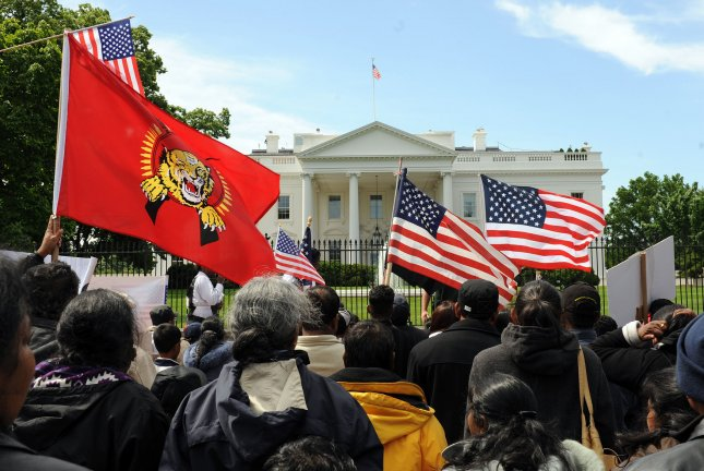 Hundreds of demonstrators call for the end of genocide against the Tamil people in Sri Lanka near the White House in Washington on May 18, 2009. (UPI Photo/Roger L. Wollenberg)