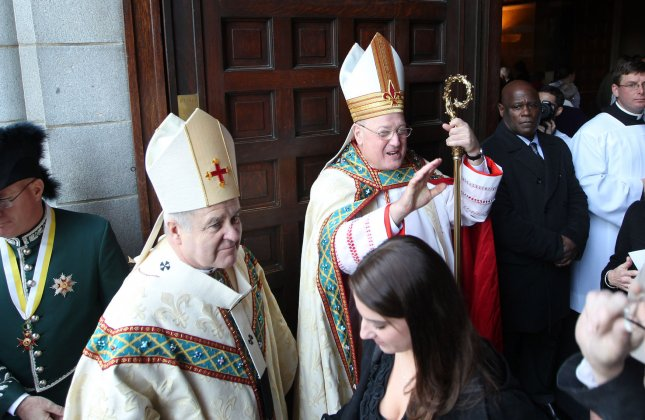 Cardinal Timothy Dolan of New York (R) and St. Louis Archbishop Robert Carlson greet friends following the funeral of former St. Louis Cardinals great Stan Musial at the Cathedral Basilica of St. Louis, Jan. 26, 2013. Musial died at age 92 Jan. 19. UPI/Bill Greenblatt