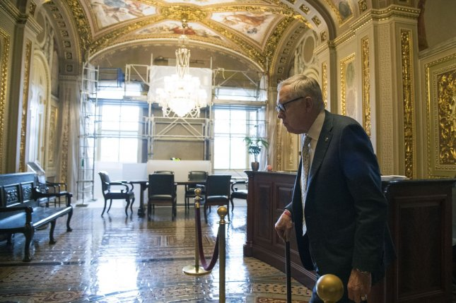 Senate Minority Leader Harry Reid, D-Nev., walks to the upper chamber after the Senate voted to override President Barack Obama's veto on a bill to allow relatives of 9/11 victims to take civil action against foreign nations shown to have been complicit, directly or indirectly, in the Sept. 11, 2001, attacks in New York and Washington, D.C. Reid was the only senator to vote against the override Wednesday. Photo by Kevin Dietsch/UPI