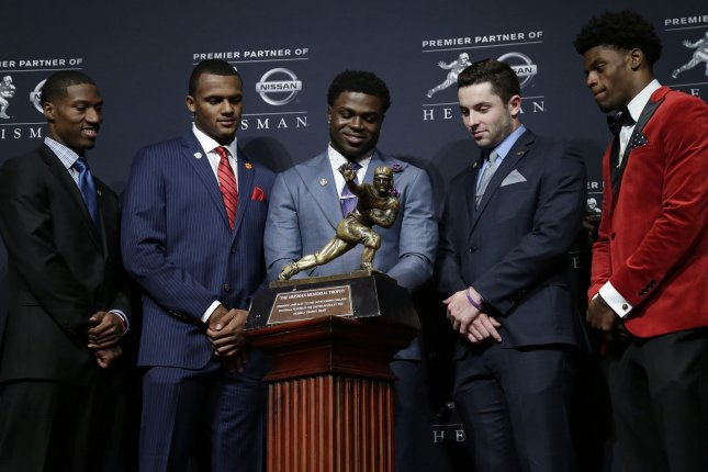 Heisman award finalists Oklahoma wide receiver Dede Westbrook, Clemson quarterback Deshaun Watson, Michigan linebacker Jabrill Peppers, Oklahoma quarterback Baker Mayfield and Louisville quarterback Lamar Jackson pose with the Heisman trophy at a press conference before the 2016 Heisman Trophy Award media event at the Marriott Marquis in New York City on December 10, 2016. Photo by John Angelillo/UPI