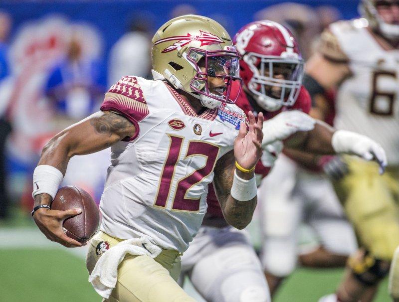 Florida State quarterback Deondre Francois scrambles against Alabama during a game September. Photo by Mark Wallheiser/UPI