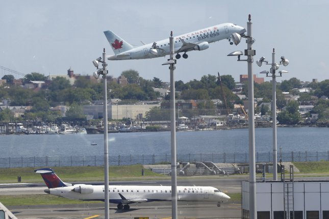The Federal Aviation Administration briefly halted all flights into LaGuardia Airport in New York City on Friday because of a shortage of air traffic controllers. File Photo by John Angelillo/UPI