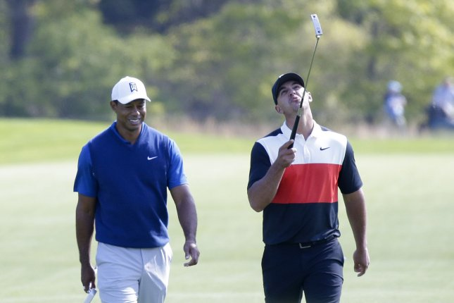 13eb613e Tiger Woods and Brooks Koepka smile as they walk to the 12th hole in the  first round of the PGA Championship. Koepka jumped out to an early lead  Thursday.