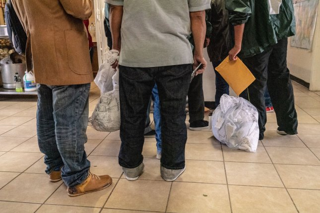 Migrants wait to get processed for their departure from a migrant shelter in Matamoros, Mexico on January 25, 2019. Some critics say proposed changes by the Trump administration, which begin a month-long comment period Monday, would effectively end asylum in the United States. Photo by Ken Cedeno/UPI