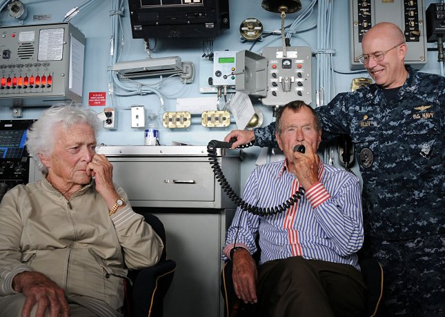 Former President George H.W. Bush speaks to Sailors via the ship's announcing system aboard the aircraft carrier that bears his name, USS George H.W. Bush (CVN 77). UPI/J. Scott St. Clair/U.S. Navy