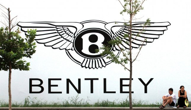 A Chinese couple sit in front of a new Bentley showroom being built in Beijing on August 12, 2011. China has almost single-handedly saved the global luxury goods market, especially high-end sports cars and sedans, due to its red-hot economy, according to industry experts. UPI/Stephen Shaver