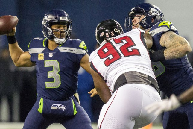 Seattle Seahawks quarterback Russell Wilson (3) gets set to pass while center Justin Britt (68) blocks Atlanta Falcons defensive tackle Dontari Poe (92) in the third quarter at CenturyLink Field in Seattle, Washington on November 20, 2017. File photo by Jim Bryant/UPI