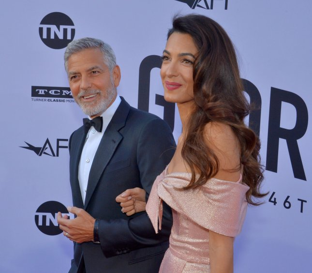 Honoree George Clooney and his wife, human rights attorney Amal Clooney, arrive for American Film Institute's 46th annual Life Achievement Award tribute gala in Los Angeles on Thursday. Photo by Jim Ruymen/UPI