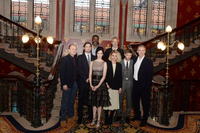 Left to right, Penny Dreadful cast-mates Rory Kinnear, Josh Hartnett, Danny Sapani, Eva Green, Billie Piper, Sam Mendes, Harry Treadaway and Timothy Dalton attend the premiere of the show in London on May 12, 2014. File Photo by Rune Hellestad/UPI