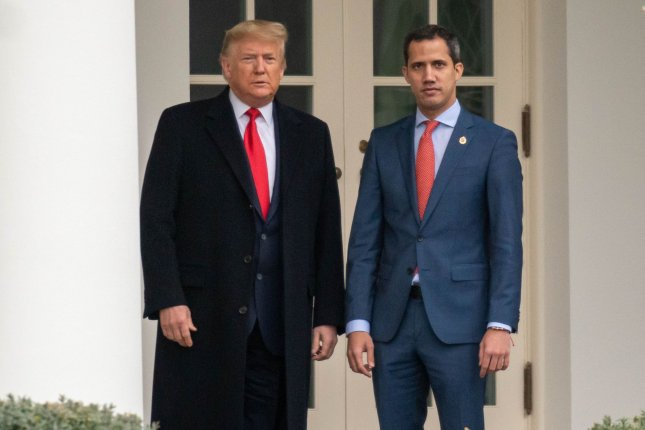 U.S. President Donald Trump stands with Venezuelan opposition leader Juan Guaido at the White House on February 5. The Trump administration on Monday sanctioned China's state-owned CEIEC for supporting embattled Venezuelan President Nicolas Maduro. File Photo by Ken Cedeno/UPI