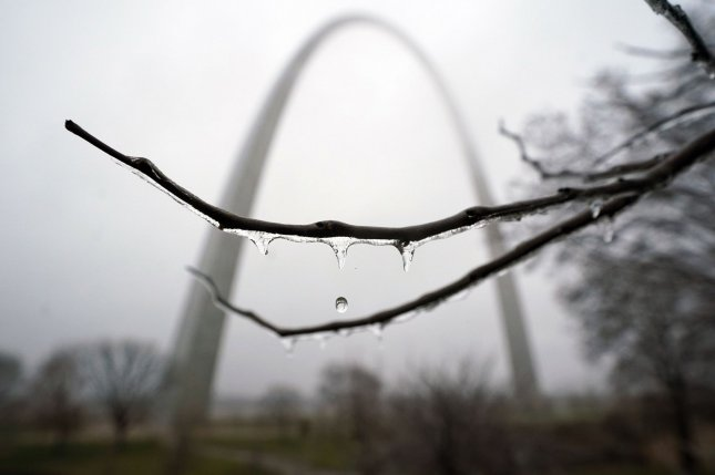 Water drips from a thin coat of ice clinging to a tree on the grounds near the famous Gateway Arch in St. Louis, Mo., on January 1. Forecasters say a large swath of the United States from the Midwest to New York City will see rain and snow in the coming days. Photo by Bill Greenblatt/UPI