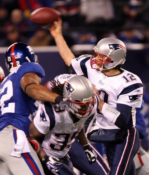 New England Patriots Tom Brady releases a pass in the first quarter against the New York Giants at Giants Stadium in East Rutherford, New Jersey on December 29, 2007. (UPI Photo/John Angelillo) .