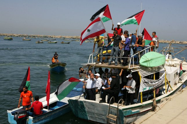 Palestinian and Lebanese flags wave over fishing boats during a demonstration in support of Lebanese ships planned to sail from Lebanon to Israel in an attempt to break the Israeli blockade on Gaza, in the sea off the Gaza City shore, on June 21, 2010. Israel warned it reserves the right to use all necessary means to stop the vessels. UPI/Ismael Mohamad