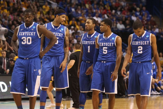 The Kentucky Wildcats walk back on the court during a game against the Wichita State Shockers in the NCAA Division 1 Men's Basketball tournament in St. Louis on March 23, 2014. Photo: UPI/Bill Greenblatt