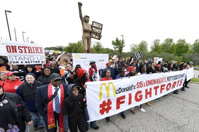 For the third year in a row, the McDonald's corporate headquarters in Oak Brook, Ill., was shut down in anticipation of planned protests -- seen here in 2015 -- demanding a wage increase to $15 per hour. The protest coincides with McDonald's annual shareholder's meeting. File photo by Brian Kersey/UPI
