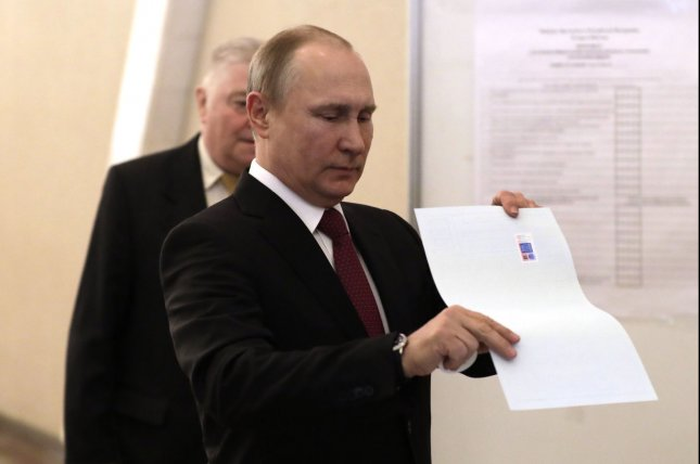 Russian President holds his ballot at a polling station during the presidential election in Moscow on Sunday. Photo by Yuri Gripas/UPI.