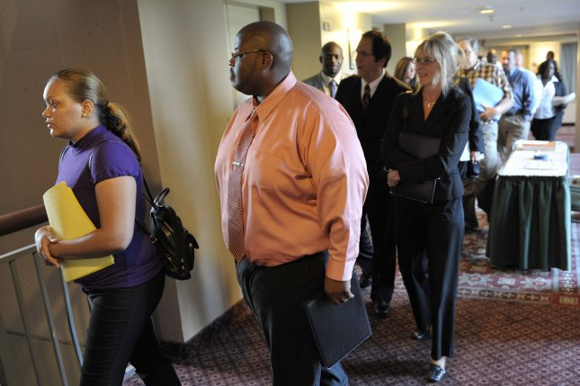 Employment seekers line up at a job fair in Lombard, Illinois. UPI/Brian Kersey