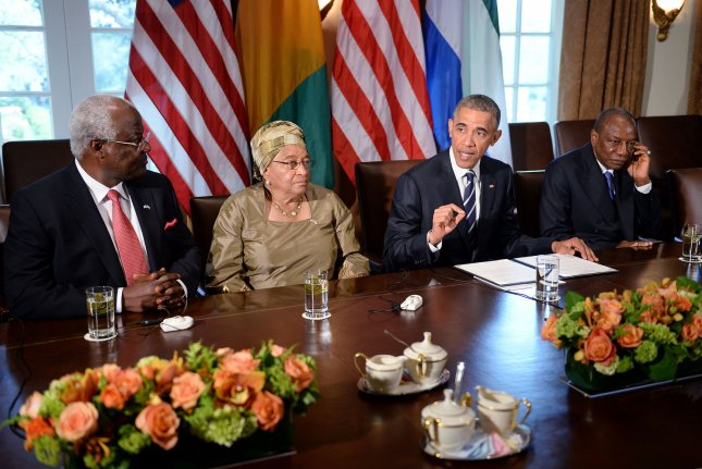 President Barack Obama speaks during a meeting with Liberian President Ellen Johnson Sirleaf, Guinea President Alpha Condé, right, and Sierra Leone President Ernest Bai Koroma, left, in the Cabinet Room of the White House. The four presidents discussed the progress made in the international Ebola response to-date. Photo by Olivier Douliery/Pool/UPI
