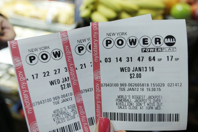 Powerball lottery tickets are held at Jessie's Express Cafe with the jackpot at 1.5 billion dollars in New York City on January 12, 2016. Illinois announced June 27 that it will no longer sell Powerball and Mega Millions tickets due to a state budget crisis. File Photo by John Angelillo/UPI