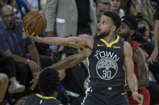 Golden State Warriors guard Stephen Curry has missed the team's previous 58 games because of a fractured hand. File Photo by Terry Schmitt/UPI