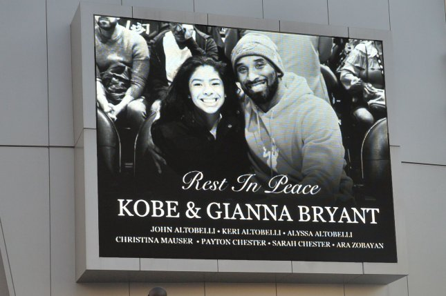 A screen outside Staples Center in Los Angeles on January 28 pays tribute to former Los Angeles Lakers star Kobe Bryant, his 13-year-old daughter Gianna and seven others who were killed in a helicopter crash two days earlier. File Photo by Jim Ruymen/UPI