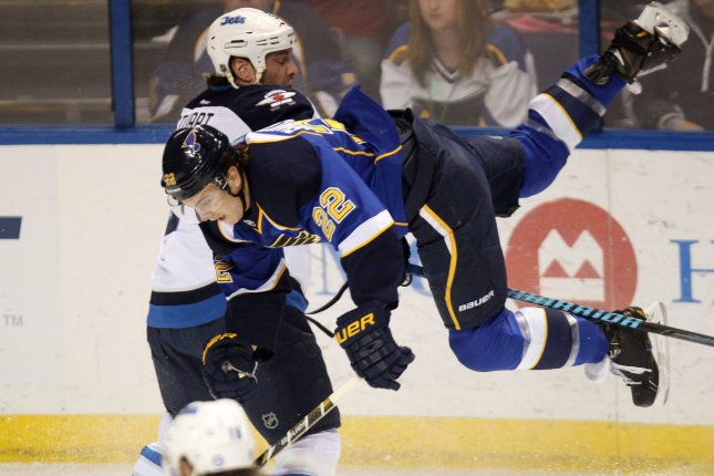 St. Louis Blues Kevin Shattenkirk goes airborne after a check by Winnipeg Jets Mark Stuart in the first period at the Scottrade Center in St. Louis on March 17, 2014. UPI/Bill Greenblatt