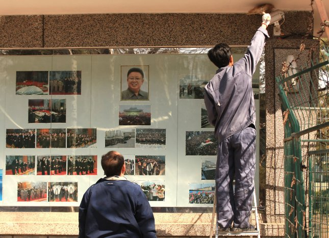 Chinese maintenance workers clean the North Korean embassy's display case in Beijing. In 2014, a North Korean smuggler of methamphetamines was executed by Chinese authorities. The use of the drug is rising inside North Korea, the U.S. State Department reported Thursday. UPI/Stephen Shaver