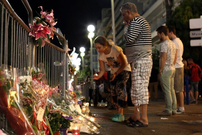 Flowers and candles line up the Promenade des Anglais as people mourn after the attack in Nice, France, on Saturday. Authorities said Monday that the suspected perpetrator performed various Internet searches before the bloody attack, including news stories on the mass shootings in Dallas and Orlando as well as violent videos. Photo by Maya Vidon-White/UPI
