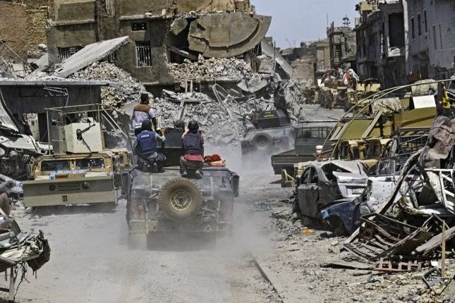 Demolished buildings and wrecked cars are seen in Mosul on July 10. Iraq announced a final victory in the nearly nine-month offensive to retake Mosul from jihadists, but Amnesty International says the coalition committed war crimes during the siege. Photo by Hana Noori/UPI