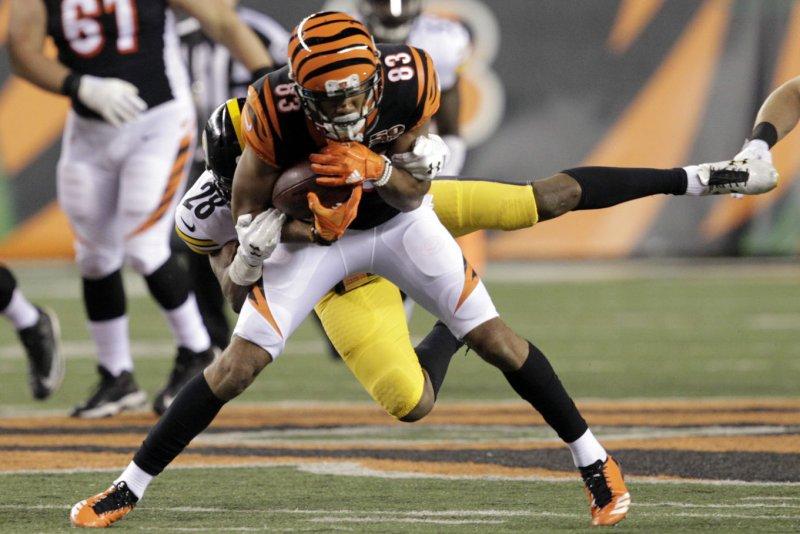 Cincinnati Bengals wide receiver Tyler Boyd (83) fights to break free from Pittsburgh Steelers defensive back Sean Davis (28) during the first half of play on December 4, 2017 at Paul Brown Stadium in Cincinnati, Ohio. Photo by John Sommers II/UPI