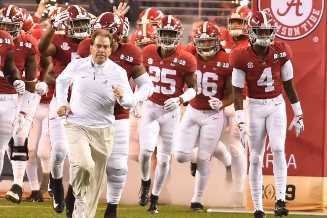 Alabama Crimson Tide head coach Nick Saban (L) used the school's mascot, Big Al, to remind people to wear masks and practice social distancing in a recent public service announcement. File Photo by Ken Levine/UPI
