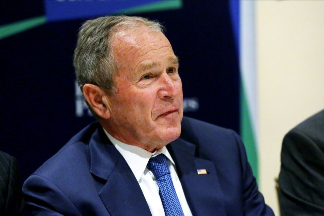 Former President George W. Bush on Sunday called for Congress to set aside harsh rhetoric and support legislation offering a pathway to citizenship for undocumented immigrants. File Photo by Monika Graff/UPI