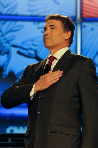Gov. Rick Perry puts his hand on his chest during the National Anthem at the Tea Party Republican Debate at Florida State Fairgrounds, in Tampa, Florida on September 12, 2011. UPI/Christina Mendenhall
