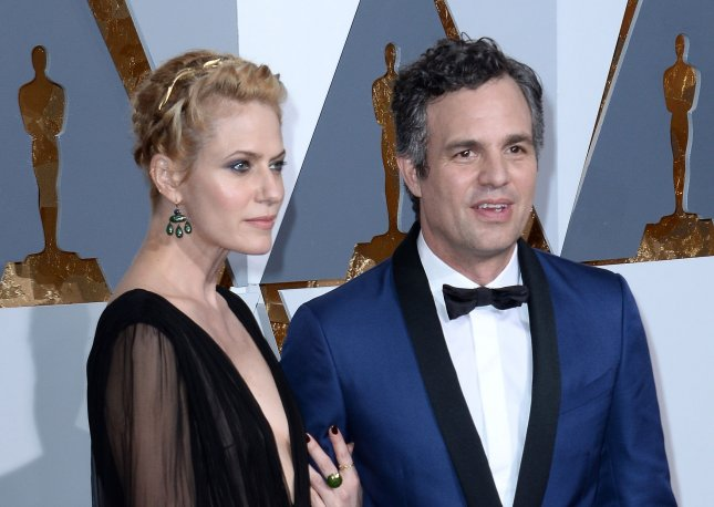 Sunrise Coigney, left, and actor Mark Ruffalo arrive on the red carpet for the 88th Academy Awards, at the Hollywood and Highland Center in the Hollywood section of Los Angeles on February 28, 2016. Ruffalo joined a group of protesters in front of a Los Angeles Catholic church to protest sexual abuse by priests. Photo by Jim Ruymen/UPI