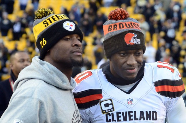 Cleveland Browns quarterback Robert Griffin III (10) and Pittsburgh Steelers running back Le'Veon Bell (26) pose for a photo after the Steelers 27-24 win in sudden death overtime against the at Heinz Field in Pittsburgh on January 1, 2017. Photo by Archie Carpenter/UPI
