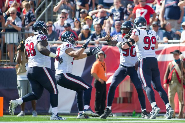 Houston Texans players celebrate after defensive tackle Jadeveon Clowney (90) scored on a 22-yard fumble recovery in the second quarter against New England Patriots on September 24 at Gillette Stadium in Foxborough, Mass. Photo by Matthew Healey/ UPI