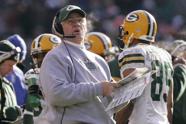 Former Green Bay Packers coach Mike Sherman looks at the scoreboard while playing against the Chicago Bears during the second quarter in 2005 at Soldier Field in Chicago. File photo by Brian Kersey/UPI Photo