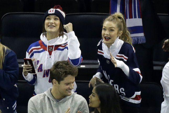 Gigi Hadid (R) and Bella Hadid attend a New York Rangers and Anaheim Ducks game on Tuesday. Photo by John Angelillo/UPI