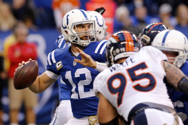 Indianapolis Colts quarterback Andrew Luck (12) throws under pressure from the Denver Broncos' Derek Wolfe (95) at Lucas Oil Stadium in Indianapolis, Ind. File photo by John Sommers II/UPI