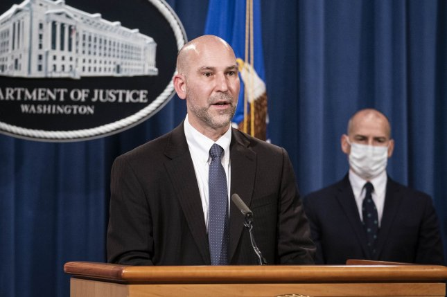 Steven D'Antuono, head of the FBI Washington field office (L) and Michael Sherwin, acting U.S. attorney for the District of Columbia, participate in a news conference at the U.S. Department of Justice in Washington, D.C., on Tuesday. Pool Photo by Sarah Silbiger/UPI