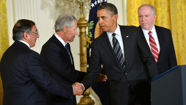 President Barack Obama (C) shakes hands with retiring Defense Secretary Leon Panetta (L) as newly nominated Defense Secretary former Sen. Chuck Hagel (R-ND) (2nd-L) shakes hands with newly nominated CIA Director John Brennan, during a ceremony where Obama announced their nominations in the East Room at the White House in Washington, DC on January 7, 2012. UPI/Kevin Dietsch