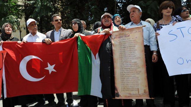 Palestinians protest the Israeli naval operation against the flotilla aid boats in front of the Turkish Consulate in east Jerusalem, June 1, 2010. Israeli commandos stormed a Gaza-bound aid ship early Monday morning, killing at nine pro-Palestinian activists on board. The flortilla ships were trying to reach Gaza with aid to break the Israeli blockade. UPI/Debbie Hill