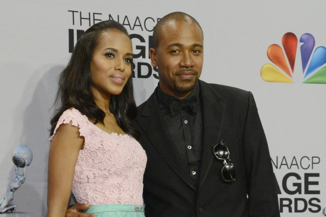 Scandal costars Kerry Washington (L) and Columbus Short appear backstage at the 44th NAACP Image Awards. (Phil McCarten/)