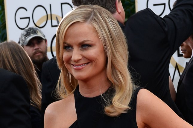 Golden Globes co-host Amy Poehler arrives for the 71st annual Golden Globe Awards at the Beverly Hilton Hotel in Beverly Hills, California on January 12, 2014. UPI/Jim Ruymen