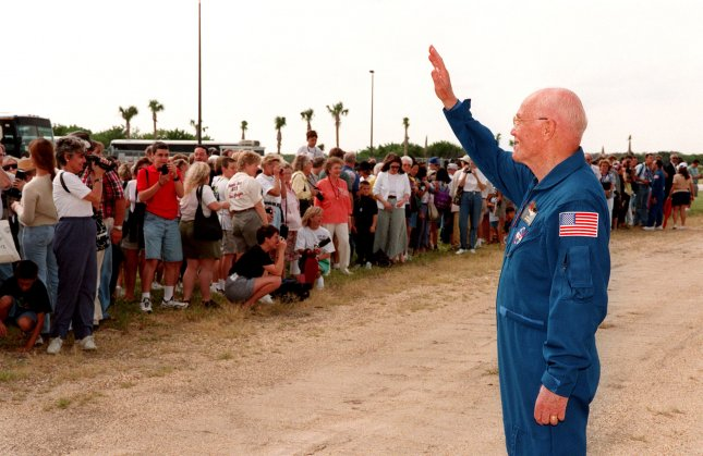 Astronaut John Glenn waves to well-wishers at the launch pad at the Kennedy Space Center on October 27, 1998, prior to final preparations for launch of the space shuttle Discovery on October 29. NASA/UPI