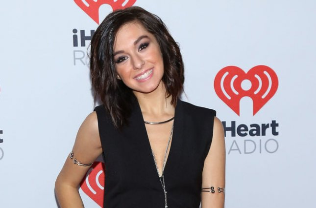 Christina Grimmie arrives in the press room for the iHeartRadio Music Festival on September 18. Grimmie's family has now filed a lawsuit against AEG Live and the Orlando venue where the singer was fatally shot in June. File Photo by James Atoa/UPI