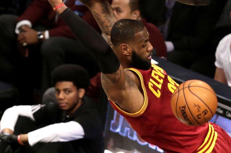 Cleveland Cavaliers' LeBron James dunks the basketball. Photo by John Angelillo/UPI