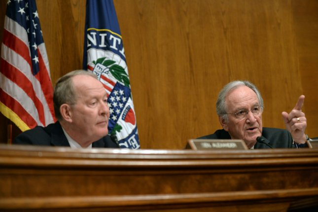 Sen. Lamar Alexander (L) and Sen. Tom Harkin attend a hearing of the Senate Health, Education, Labor and Pensions Committee. Tuesday, Alexander said the panel will hold two hearings next month on stabilizing the ACA health exchange markets. File Photo by Kevin Dietsch/UPI